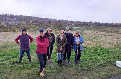 Volunteers planting trees in Dewsbury